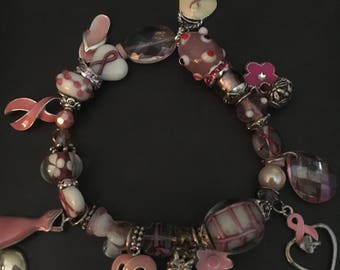 Pink cancer charm and beaded bracelet