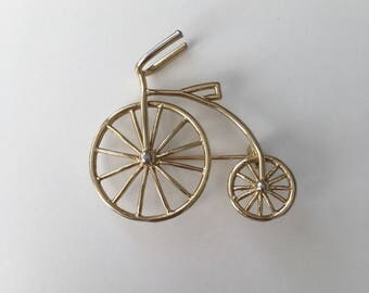 Gold vintage bicycle brooche