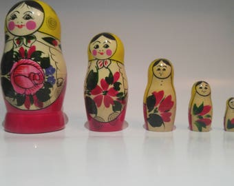 Russian nesting doll (Matryoshka) yellow Babushka and flower LILIA
