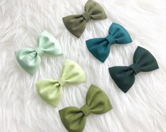 Green tinted earrings