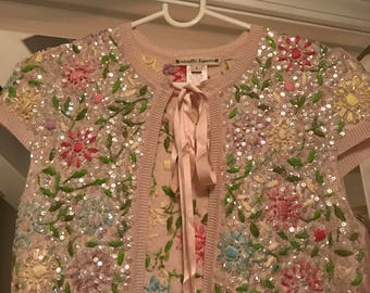 Pink sequins shrug w/ satin bow closure