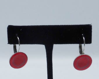 red graphic earrings in polymer clay