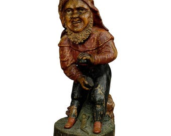 whimsical carving of a dwarf with snuffbox 19th century
