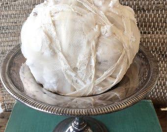 Ivory Rag Ball on Silver Pedestal