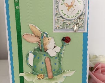 Bunny in a watering can