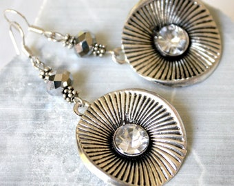Silver metal round earrings.