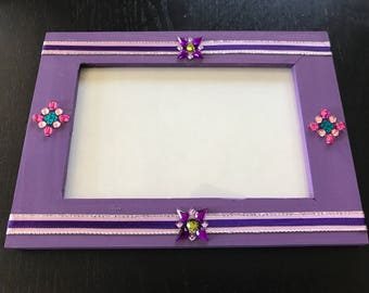 purple embellished picture frame edge with a purple and pink silver ribbon, and adorn gems