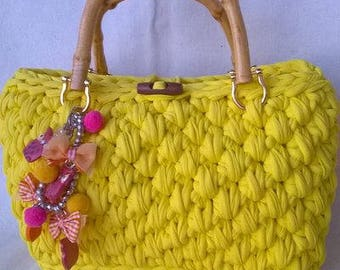 Crochet handbag of a beautiful canary yellow lycra ribbon color with bamboo handles an pendant bracelet