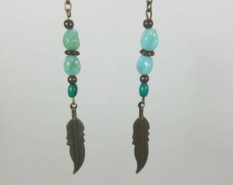 Brass feather with teal/blue-green beads dangle earrings