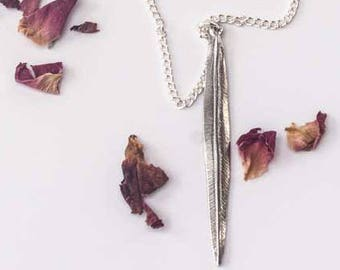 Macaw feather necklace. Cornish Pewter.