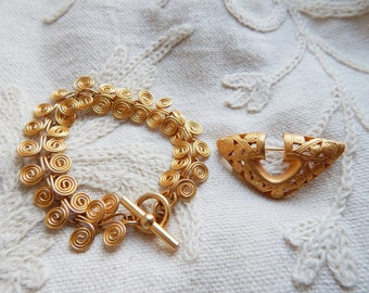 A Vintage Mid 1990s Brooch in the  Form of a Pre-Columbian Gold Artefact and a matching Matte Gold Spiral Design Bracelet