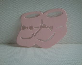 Cut baby booties in pale pink design for scrapbooking or card paper