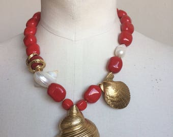Necklace features vintage bronze gold glass bead shell.