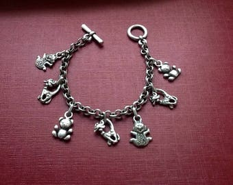 Bracelet with charms in antique silver