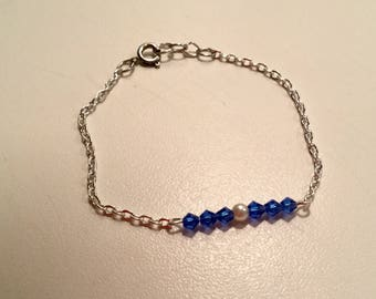Blue beads and silver plated chain bracelet