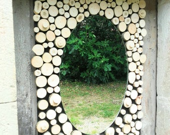 Oval mirror, framed wood slices