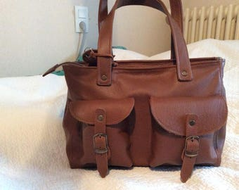 Tan leather bag has pockets
