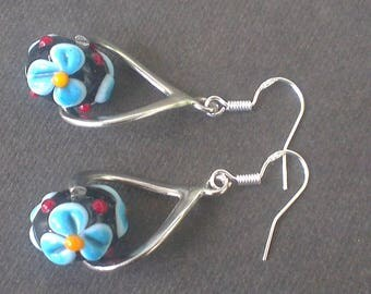 Lampwork Glass Beads: blue flowers on a deep black background
