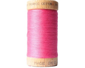Thread to sew. Pink neon. Organic cotton