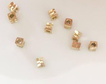 set of 10 gold metal beads
