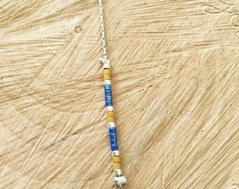 Metal bracelet with blue and mustard miyuki beads