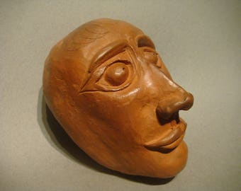Raw clay oilcloth face says: Vladimir Vladimiroff