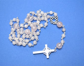 Silver plated Rosary with rose quartz and topped with cubic zirconia cross