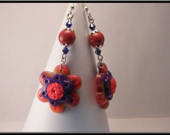 Flower polymer clay and bead earrings.