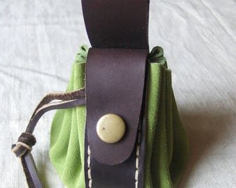 Purse is Mint green-brown leather completely hand