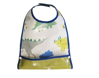 Bib oilcloth with dinosaurs pattern system