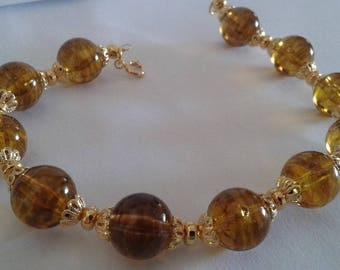 Transparent Brown pearl bracelet and Golden cups