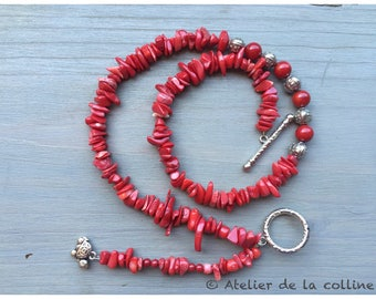 Necklace in coral and Tibetan beads with charm