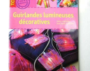 """Livre """"Guirlandes lumineuses décoratives"""" Editions Didier Carpentier."""