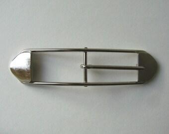 120 x 28 mm, silver metal rectangular belt buckle.