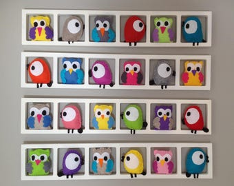 Child and baby room wall frame for decoration. Multicolored owls and birds