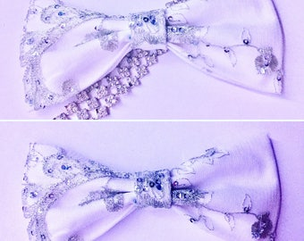 White bow with glitter special evening