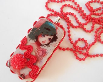 Red bead and vintage domino pendant chain necklace.