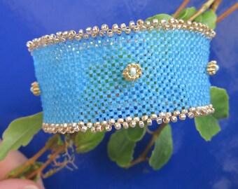 sky blue and gold woven bracelet