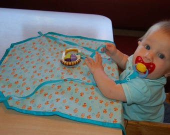 Placemat for babies and toddlers, reusable, portabel, restaurant or home, patented design with attached straps, great gift for babies