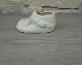 White porcelain baby shoe