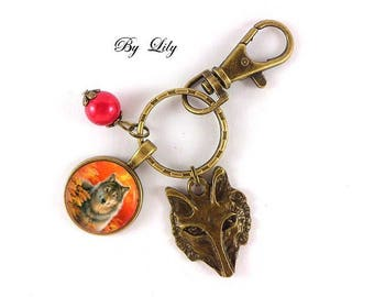 """Keyring """"Wolf grey and sunset"""", retro picture cabochon"""