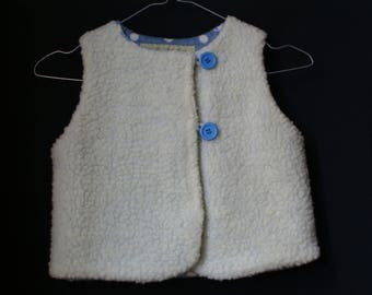 light blue Interior ecru sheep vest has very soft dotted fabric