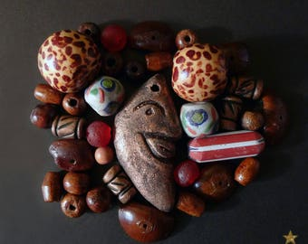 34 glass African beads, wood, seed, and terracotta