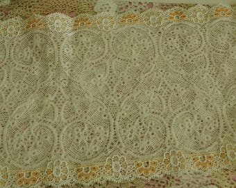 Ivory lace and salmon finely perforated patterned polyester slightly elastic 17.00 cm width
