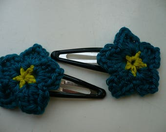 2 pins with blue-green crochet flower hair