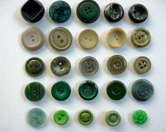 Assortment of 25 green shades of opaque plastic buttons sizes varying diameters 1.4 cm by 2.2 cm