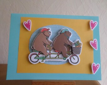 card with two bears in tandem