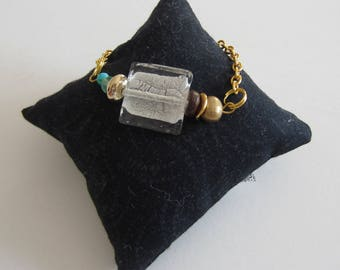 Bracelet, golden chain flat, square glass bead transparent and silver and beads