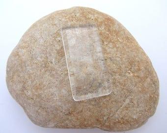 A glass transparent rectangular Cabochon to stick
