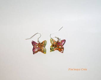Multicolored butterflies and original, ethnic earrings